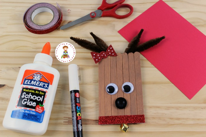 Learn how to make cute DIY Reindeer ornaments from craft sticks! These are easy enough for kids to make. They look great on the tree, and make perfect kid-made gifts.
